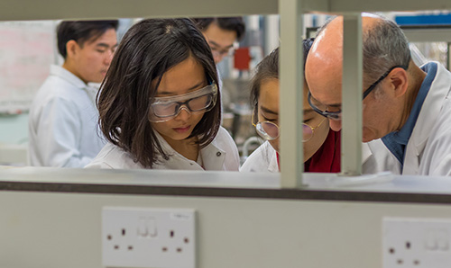 Female students working together in their lab coats
