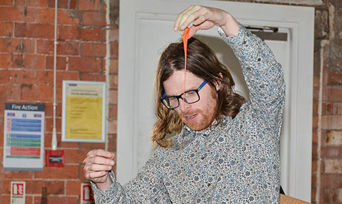 Teacher demonstrating a materials science experiment