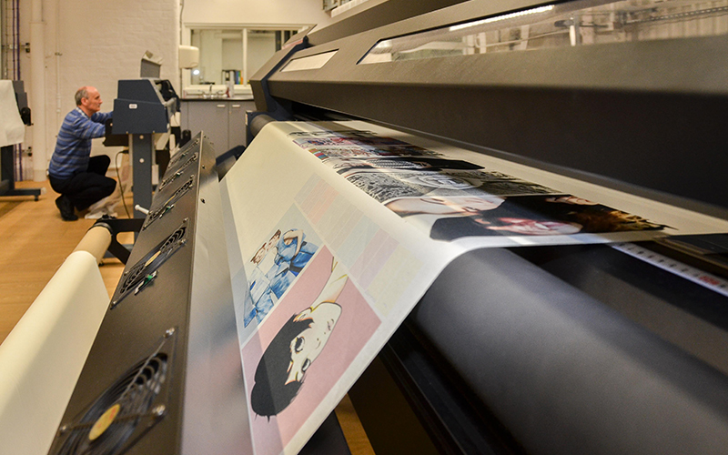 Patterned paper emerging from printing machinery