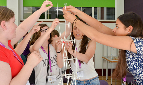 School pupils building a structure as part of a Materials summer school