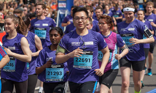 Section of purple wave - university staff and students in Manchester 10K