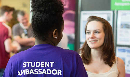 Woman at open day talking to Student Ambassador