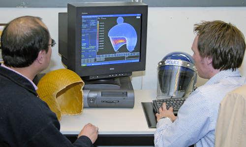 Student and tutor looking at police helmet design on computer screen