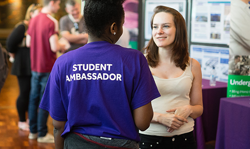 A student ambassador in conversation with a prospective student on an open day